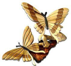 "https://flic.kr/p/4DffGR | Intarsia Butterflies on Redwood | Custom order of Intarsia Poplar and Black Walnut Butterflies mounted on a flame redwood burl slab.  Store order for ""Handmade Colorado"" in Castle Rock, CO."