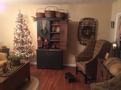 Green stepback cupboard. Santa's by Arnett's Country Store.