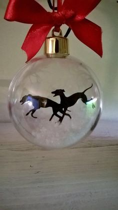 greyhounds in snow ornament