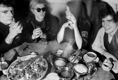 Janis Joplin is seen here dining with fellow musician Paul Morrissey and artist Andy Warhol at Max's Kansas City in 1968.