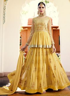 Light Yellow Embroidered Royal Georgette Anarkali features a gorgeous royal georgette top alongside a santoon inner and bottom. A chiffon dupatta completes the look. Embroidery work is completed with zari, thread, and stone.