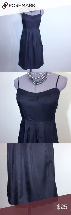 """🆕Listing: Juicy Little Black Silk Slip Dress A Must Have! Juicy Little Black Silk Slip Dress. In great condition. Size 4 measures: 16"""" across chest, 14"""" across ribs, 22"""" across hips, 32"""" long, has adjustable straps and side zip close. The scallop hem is the perfect touch for this wardrobe staple LBD. 100% silk and fully lined with 96% poly, 4% spandex Blend. The is no stretch in the silk. 502/100/051617 Juicy Couture Dresses"""