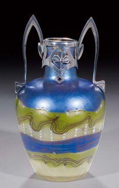 https://new.liveauctioneers.com/item/1757238_seltene-vase-phnomen-in-tiffany-art-mit-metall