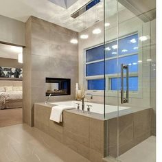 Inspiration for a contemporary bathroom in Calgary with an undermount tub and beige tile.