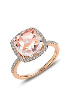 Pavé simulated diamonds amplify the glow of this multifaceted simulated-morganite center stone, while 18-karat rose-gold plating completes the warm color palette.
