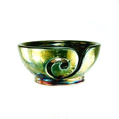 Ohhh.... shiiiinnny.   https://www.etsy.com/listing/196756443/cybele-ceramic-yarn-bowl-raku-pottery