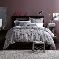 The purple an grey look so good together!  I have grey walls and added ourple comforter set to my registry  for our bedroom!