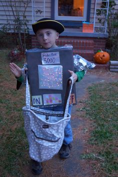 Robot costum Box, duct tape, battery opperated lights, scrapbook paper, spray pant, tin foil  = one super happy little boy, and only $6 and we have used it 2 years so far