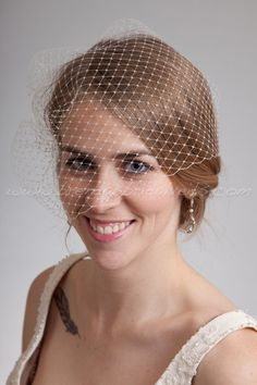 This beautiful full side blusher style birdcage veil is approximately 13 and is attached to a metal comb. This can also be position with the
