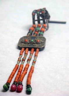 Tibet | Earrings; silver, coral and jade | 19th century