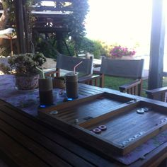 Enjoy evening coffee (frape) and preparing for a backgammon game...