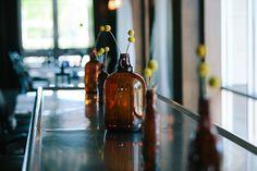 Growler vases!!! Yes PLEASE! by Harborside East, via Flickr