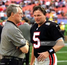 Atlanta Falcons head coach Dan Reeves(L) talks to Falcons kicker Morten Andersen (R) before the start of Super Bowl XXXIII 31 January at Pro Player Stadium in Miami, FL. The defending champion Denver Broncos will face the Atlanta Falcons. (ELECTRONIC IMAGE) AFP PHOTO/Jeff HAYNES