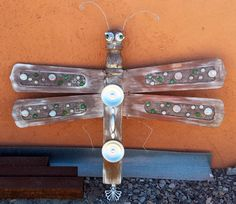 Allie's Dragonfly. Ceiling fan blades, old bed post, glass bubbles, assorted hardware and junk metal. Sold. Recycle upcycle repurpose scavenge assemblage