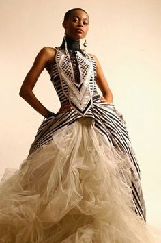 Spectacular cream wedding dress with cascading tulle and geometric prints. on The Fashion Time  http://thefashiontime.com/37-gorgeous-african-wedding-dresses/#sg21