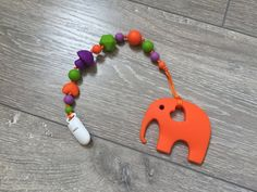 Silicone orange elephant teether with pacifier clip от TeetherLand