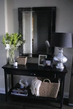 Table, large mirror, statement lamp