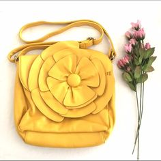 Yellow Flower Purse Charming Charlie's yellow flower purse. In perfect condition only used once. Charming Charlie Bags Satchels