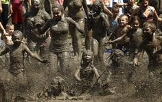 Children at the annual Mud Day in the Detroit suburb of Westland. Every year, hundreds of kids get to jump into a giant 75ft-by-150ft pit of mud.