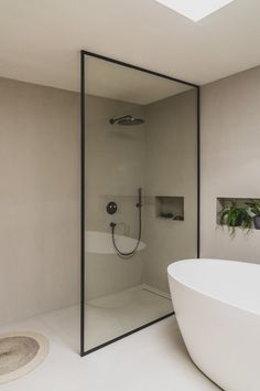 The shower screen with steel and glass gives your mortex bathroom an open feel. The clean white bath suits perfectly with the beige mortex color. The skylight provides your plants the right amount of light. M-CREATIONS, Belgium. Beige Bathroom, Laundry In Bathroom, Bathroom Design Luxury, Bathroom Design Small, Dream Home Design, Home Interior Design, Bathroom Design Inspiration, Minimalist Bathroom, Beautiful Bathrooms