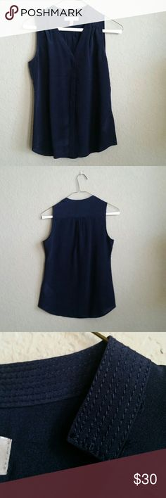 PETITE Banana Republic Navy Blue Silk Shell Top Brand: Banana Republic Size: XXS, Petite Material: Silk  Condition: Never worn, no tags, excellent condition Notes: Purchased in 2014, Sleeveless top  **Item comes from a pet free and smoke free home** Banana Republic Tops Blouses