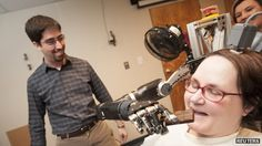Paralysed woman's thoughts control robotic arm.