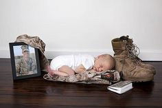 baby with daddy's soldier stuff