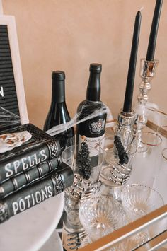 How to design the perfect Halloween bar cart with a few simple tips | Halloween bar cart decor, Halloween bar cart ideas #barcart #halloweendecor Wine Glass Set, My Glass, Candy Display, Bar Cart Decor, Halloween Decorations, Table Decorations, My Bar, Taper Candles