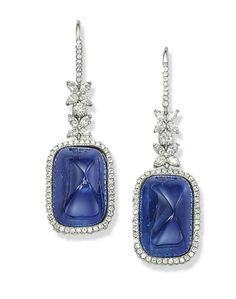 A PAIR OF SAPPHIRE AND DIAMOND EAR PENDANTS   The two cabochon sapphires, weighing approximately 29.51 and 25.19 carats, within a micro-pavé diamond surround, and suspended from a marquise-shaped diamond flower surmount, mounted in platinum, 4.5 cm