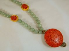 Cinnabar Pendant and Jade Bead Necklace / Vintage Genuine Heavy Jade Necklace / Large Floral Carved Red Cinnabar Wood Pendant by VintageBaublesnBits on Etsy