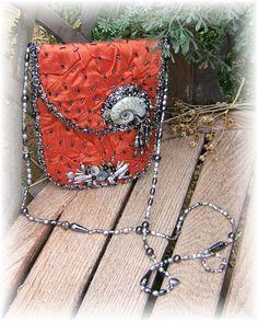 Orange Dupioni Silk pouch with freeform beadwork by Cindy Chavez...