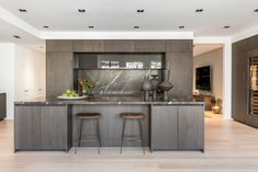 The kitchen island is the social area of the kitchen. * * * The kitchen island is the social area of the kitchen. Kitchen New York, Loft Kitchen, Kitchen And Bath, Black Countertops, Kitchen Countertops, Kitchen Island, Dark Wood Kitchens, Dark Wood Cabinets, Bath Remodel
