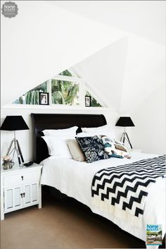 This black and white master bedroom is both light and sophisticated