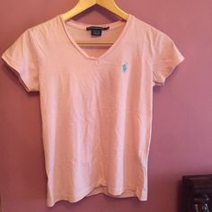 Polo Shirt Baby pink Ralph Lauren polo v-neck. Logo is baby blue. Gently worn, no flaws. Polo by Ralph Lauren Tops Tees - Short Sleeve