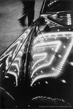 Harold Feinstein. Times Square Lights Reflected on Car, 1953