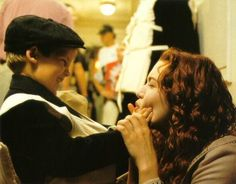 Kate Winslet having fun with one of the kid extra's - Titanic (1997)