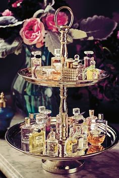 Mini perfume bottles double up as décor and favours in this elegant display, as seen on BridesMagazine.co.uk (BridesMagazine.co.uk)