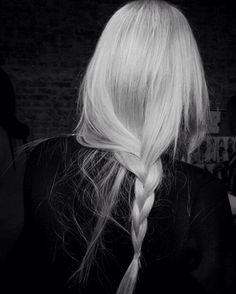 White Blonde, Low Braid. Wispy. Pieces of hair not captured in braid fall forward to frame face. | LA COOL & CHIC