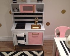 Kids play kitchen made from tv cabinet by kathyleeskreations