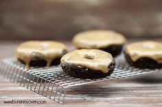 Peanut Butter Glazed Chocolate Doughnuts recipe from Buns In My Oven