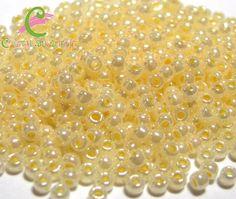 th11-901.  15 gramos rocalla 11/0 TOHO ceylon rice pudding  2 - 2,2  mm. de Cristalbijouterie en Etsy