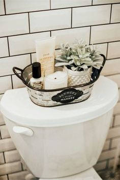 Home Decor Apartment Farmhouse bathroom decorating ideas - cheap farmhouse decor ideas for decorating your home on a budget.Home Decor Apartment Farmhouse bathroom decorating ideas - cheap farmhouse decor ideas for decorating your home on a budget Boho Bathroom, Bathroom Toilet Decor, Bathroom Baskets, Bathroom Vanities, Black Bathroom Decor, Farmhouse Decor Bathroom, Basement Bathroom, Bathroom Bin, Master Bathroom
