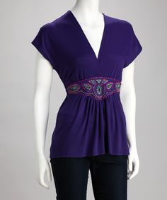 Purple Surplice Paisley Top  I just love this style top - it looks good on so many figures and bust sizes - easily transitions from office to out-for-the-evening too!   #projectidea #searchforpattern #sewing