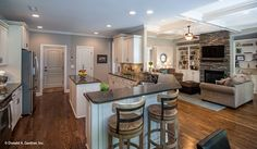 Bar seats overlook the #kitchen and great room in this open living #home plan. The Weatherford - Plan 1053. http://www.dongardner.com/house-plan/1053/the-weatherford. #DreamHome
