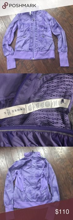 Purple Lululemon Jacket Lightweight zip up jacket. Has ruffles and purple swirl design. In excellent condition. Size 6 and fits tightly. lululemon athletica Jackets & Coats
