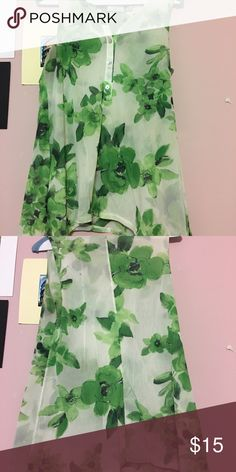 Green floral blouse Green floral blouse, gently used. Some signs of wear around armpit but not noticeable. New York & Company Tops Blouses