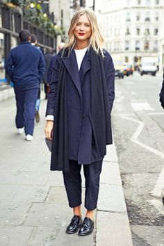 london street style street chic - red lipstick lends a feminine touch To that more masculine outfit.
