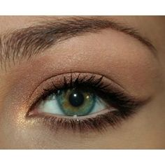 Apply golden-light brown eyeshadow on and above the eyelid. Highlight the inner corner of the eye with gold shimmer eyeshadow. Apply a mocha shimmer eyeliner to top and bottom lashes, connect lines and add a cat eye flick.