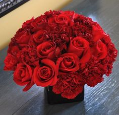 red carnations and roses--- simple centerpieces...Found on Weddingbee.com Share your inspiration today!
