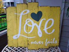 Love never fails pallet sign mustard yellow white and by NWPallets